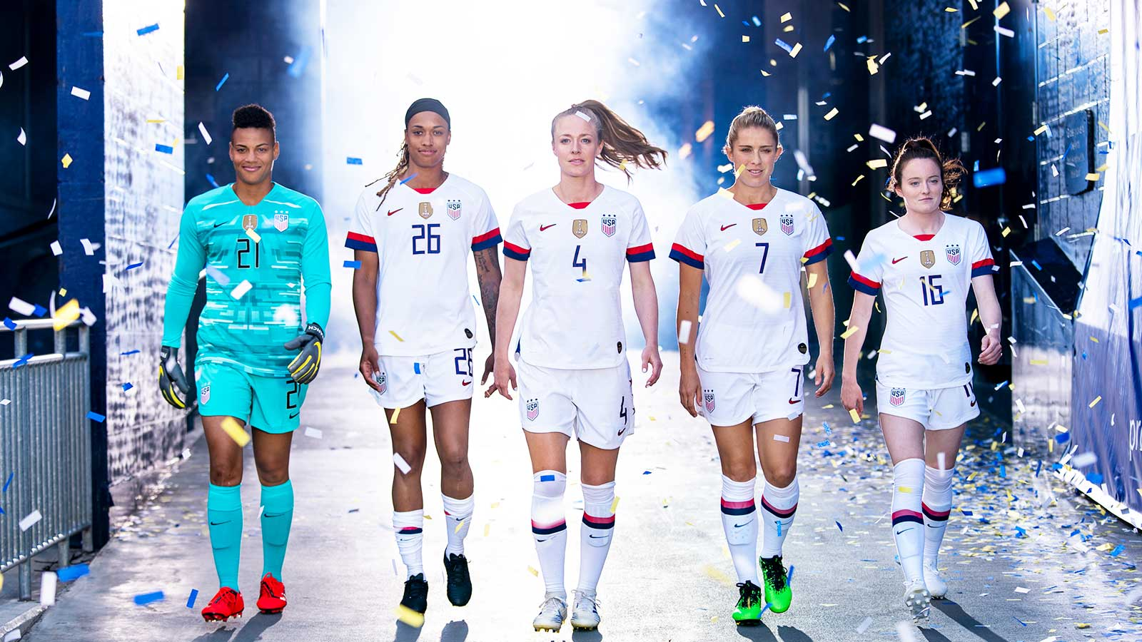 FIFA Women's World Cup USA team walking into a stadium with confetti falling through the air.
