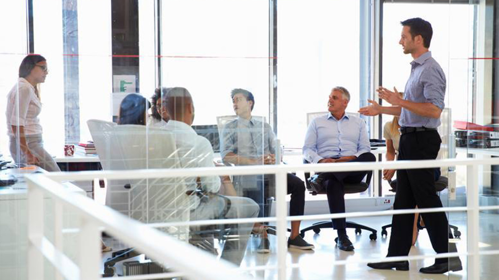 Group of business people in office discussing ideas.