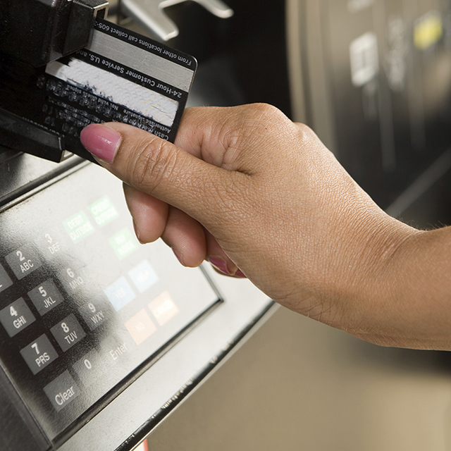 hand with credit card at pump