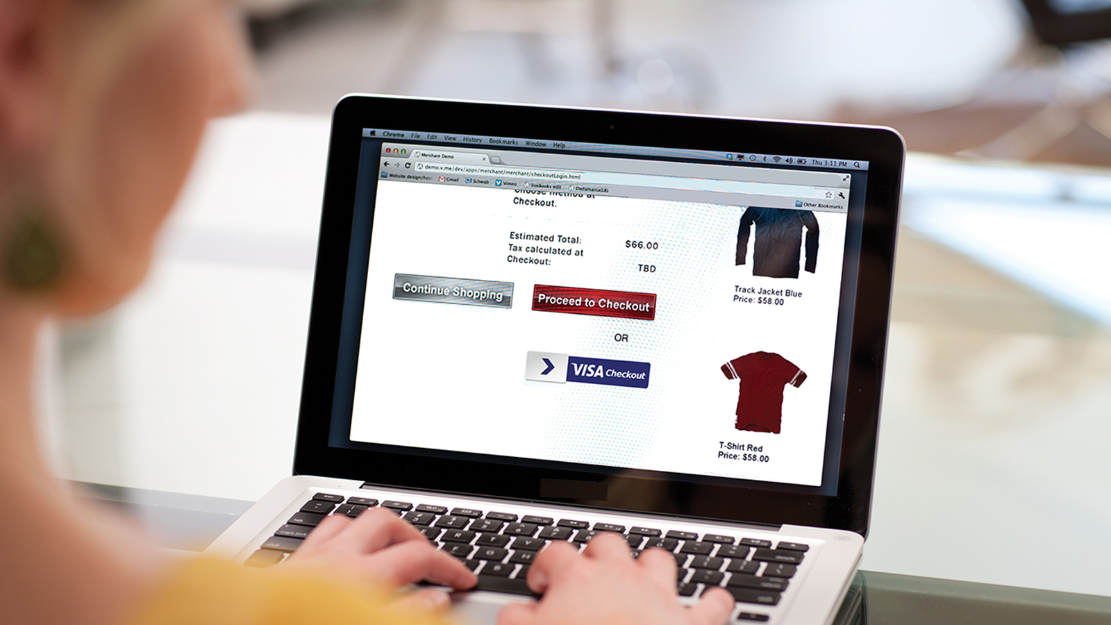 Woman on a laptop using the Visa Checkout option to complete an online purchase.