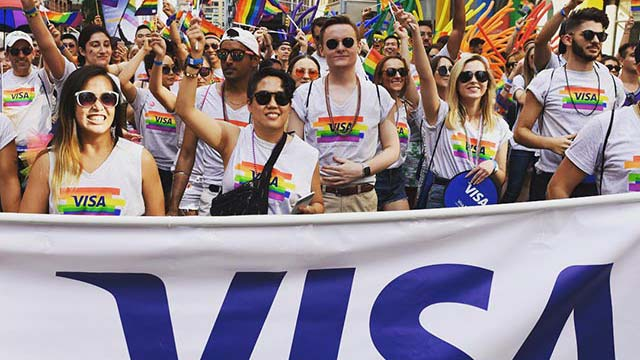 Group of Visa employees marching in New York Pride parade
