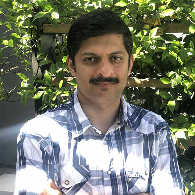 Headshot image of Visa research scientist Mangesh Bendre.