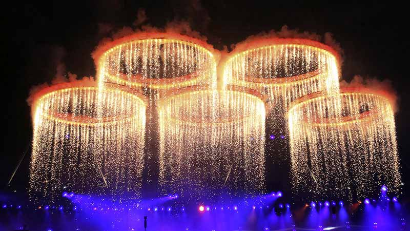 Olympic symbol: five interlaced rings of blue, yellow, black, green and red.