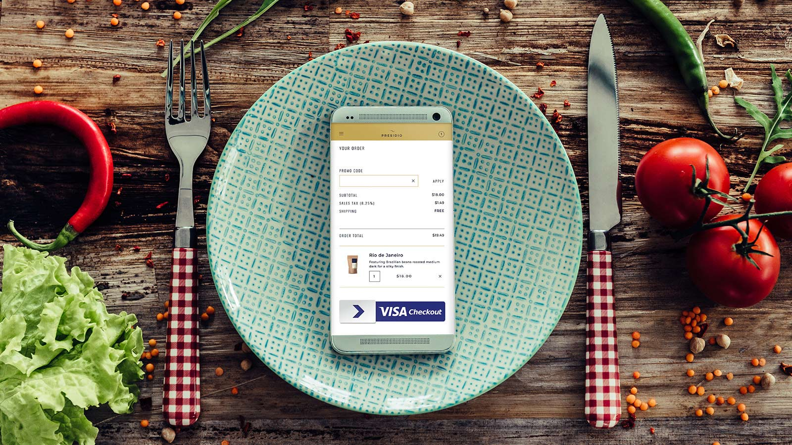 Mobile phone on top of a plate with the Visa Checkout logo visible on screen.