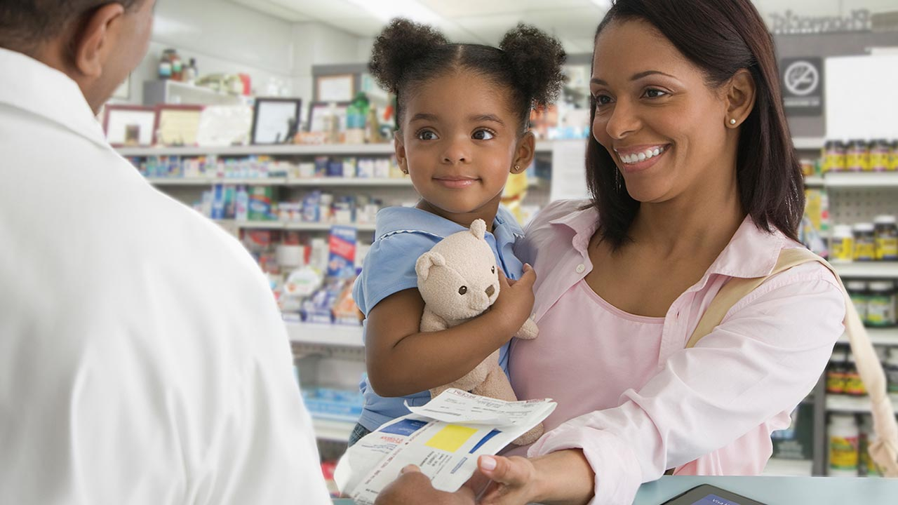woman and child receiving prescription