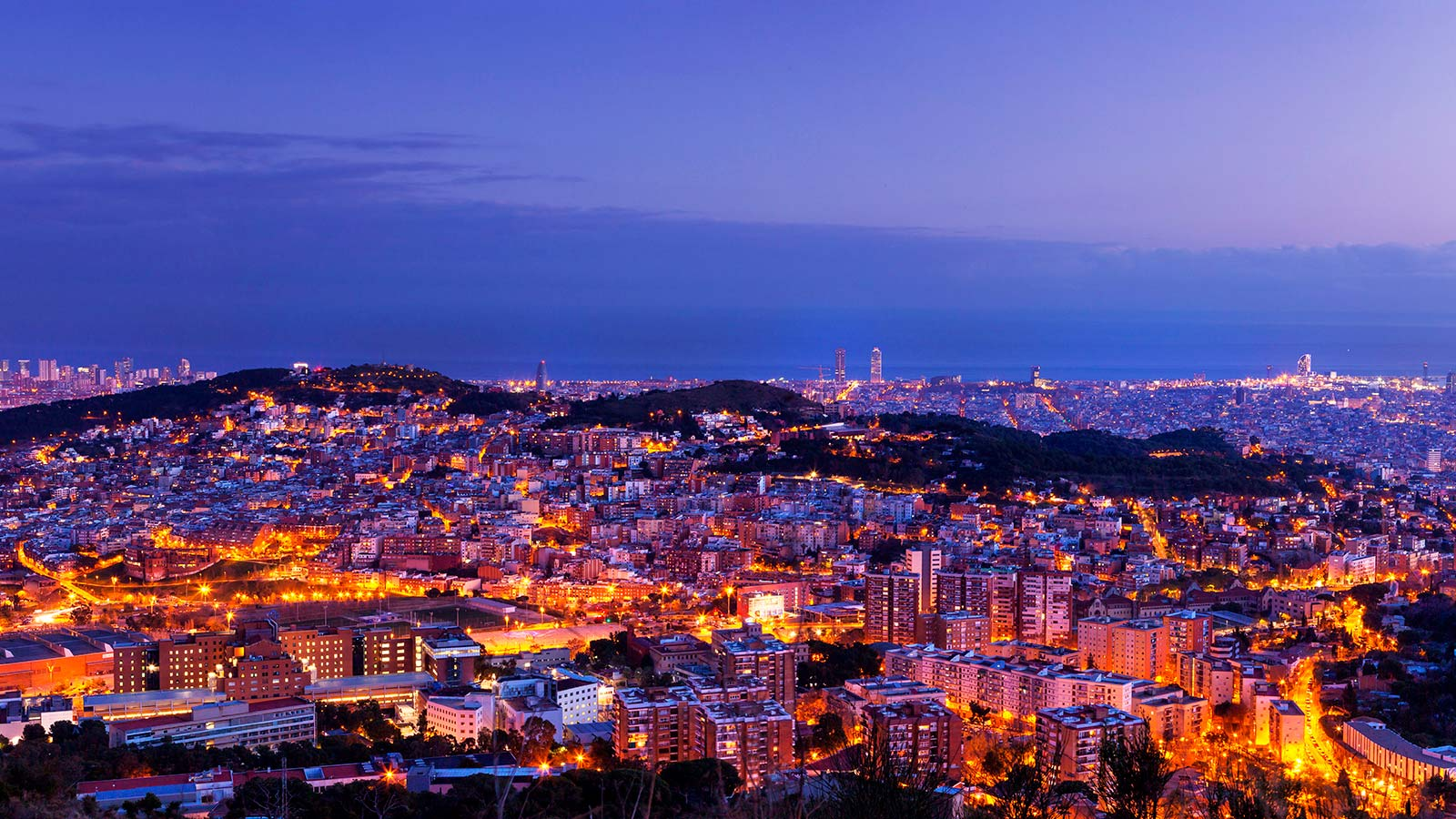 Barcelona skyline at dusk.
