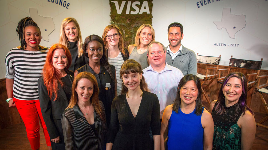 A group of Visa employees celebrating International Women's Day posing for a group picture.