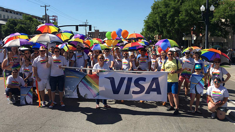 utah pride and visa on a parade