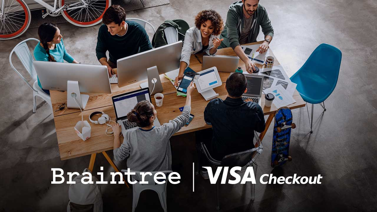 Braintree and Visa Checkout logos superimposed on a group of people sitting around a large office work table.