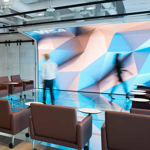 A stylish shot features a meeting area in the Visa Design studio.