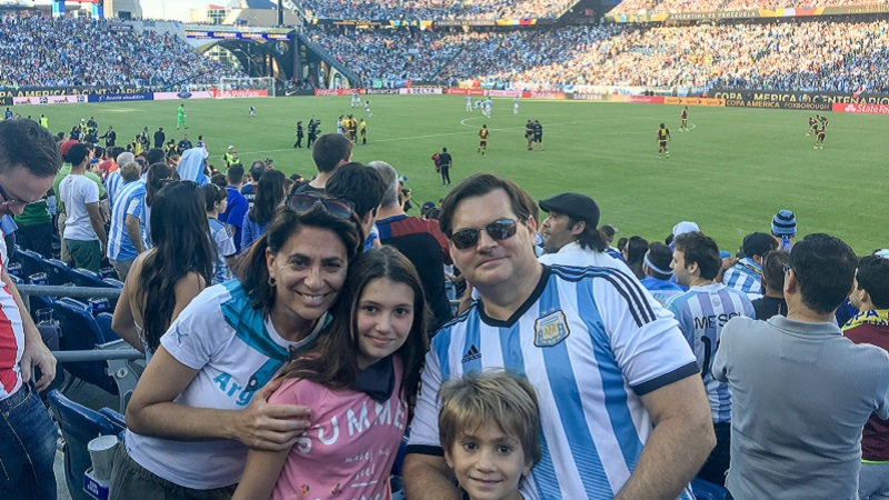 Romina Seltzer with her kids and husband at an Argentina vs. Venezuela football match played in the U.S.