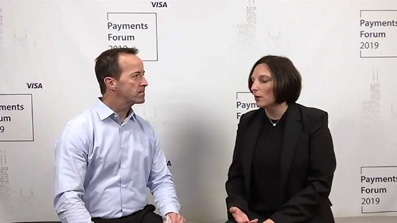 April Clobes talking to an interviewer at the Visa Payments Forum 2019.