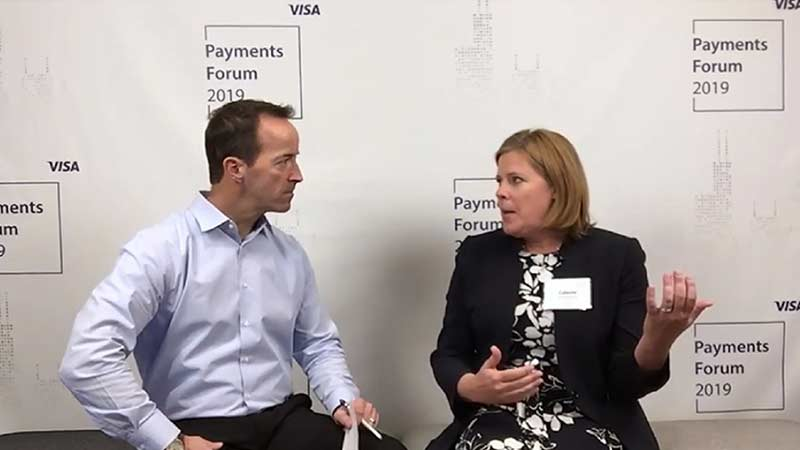 Celeste Schwitters talking to an interviewer at the Visa Payments Forum 2019.