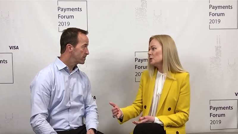 Mary Ann Reilly talking to an interviewer at the Visa Payments Forum 2019.