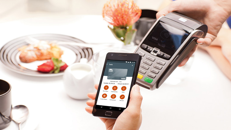 Mobile credit card payment at a restaurant.