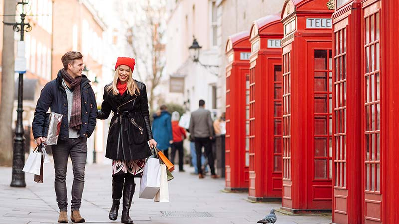 A young couple walking on a London street.