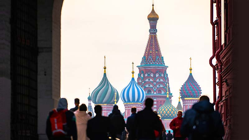 Silhouetted tourists admire St. Basil's cathedral in Moscow, Russia.