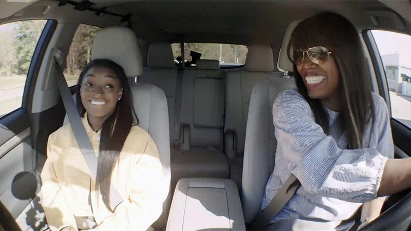 Olympic Athlete Simone Biles rides in Visa's connected car with Visa VP, Olabisi Boyle.